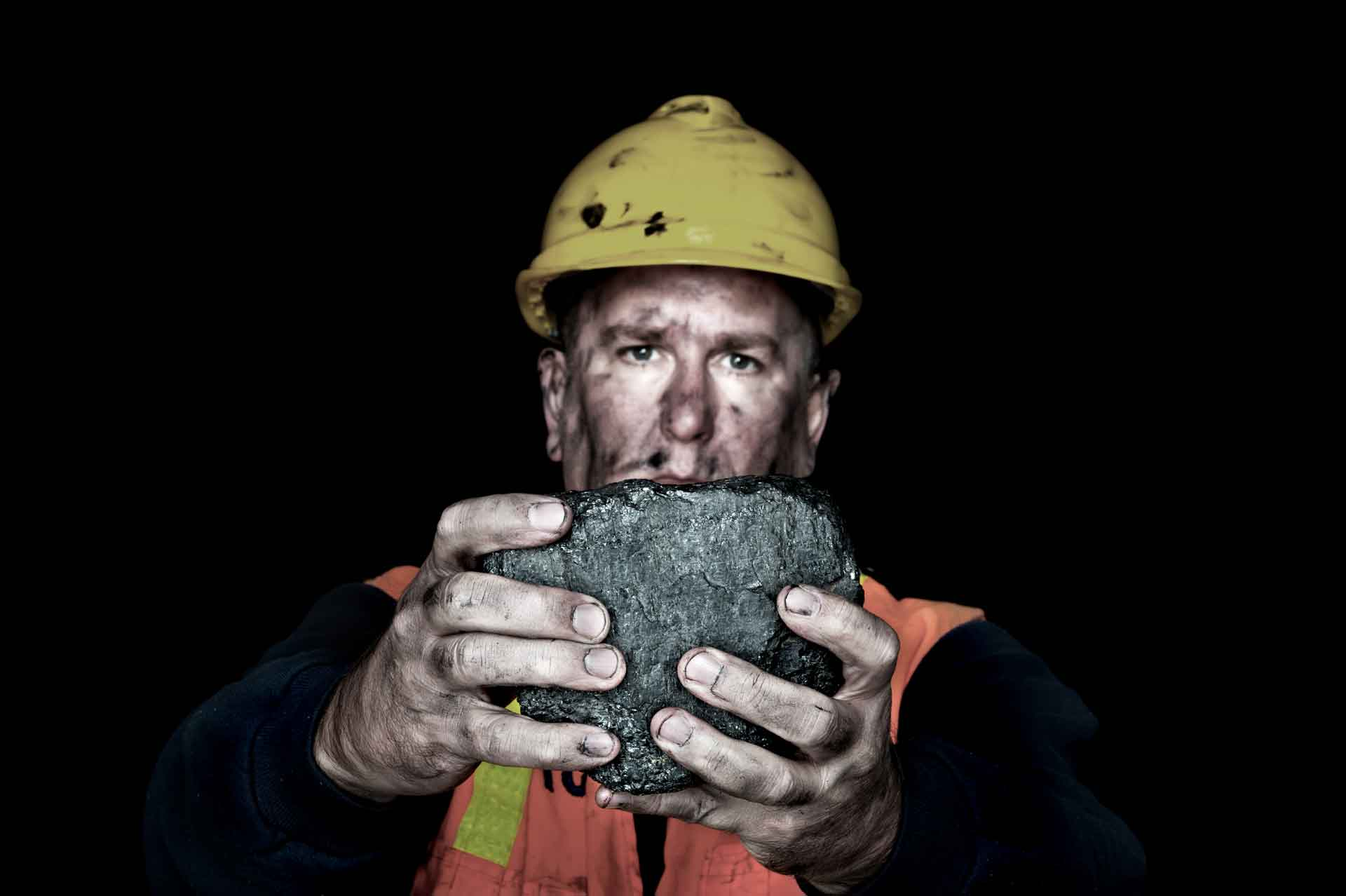 Lump of coal underground miner